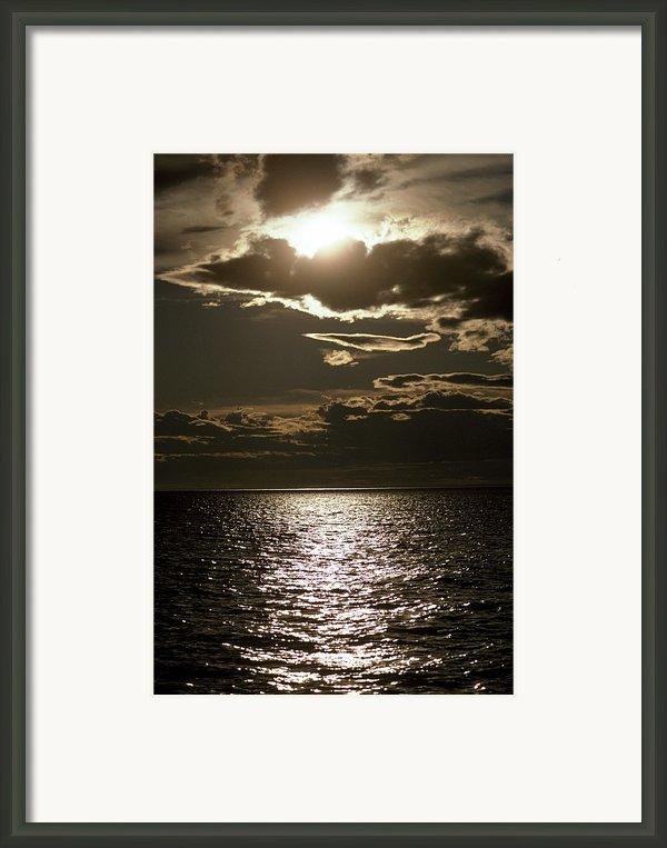 The Setting Sun Pierces A Menacing Framed Print By Jason Edwards