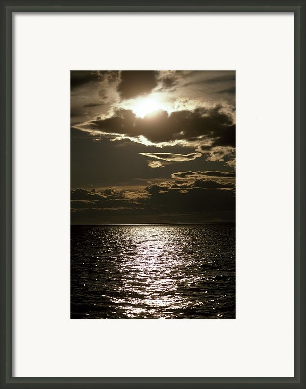 The Setting Sun Pierces A Menacing Framed Print By Jason Edwards