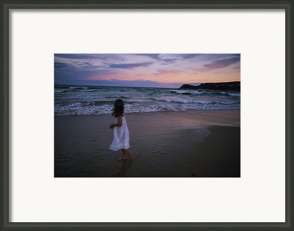 The Sun Begins To Set Over Manley Framed Print By Annie Griffiths