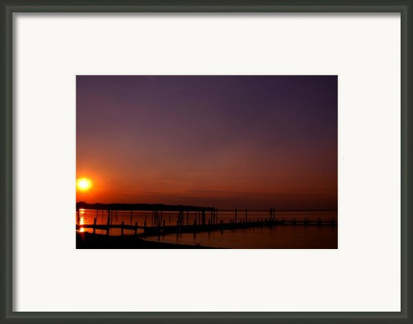 The Sun Sets Over The Water Framed Print By Clayton Bruster