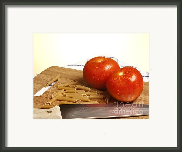 Tomatoes Pasta And Knife Framed Print By Blink Images
