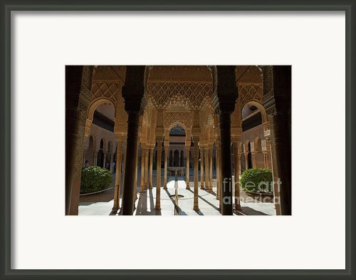 Tourists In The Courtyard In The Patio De Los Leones Area At Alhambra Framed Print By Sami Sarkis