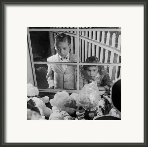 Toys In Window Framed Print By Orlando