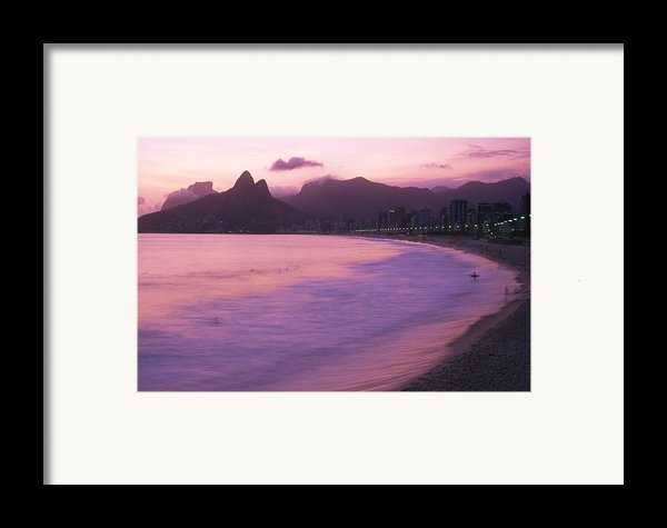 Twilight View Of Ipanema Beach And Two Framed Print By Michael Melford