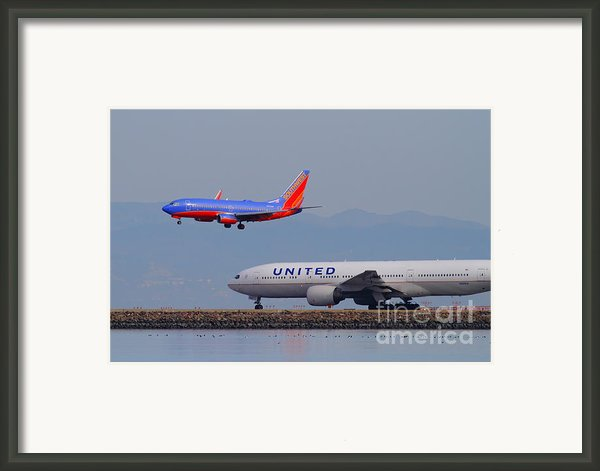 United Airlines And Southwest Airlines Jet Airplane At San Francisco International Airport Sfo.12087 Framed Print By Wingsdomain Art And Photography