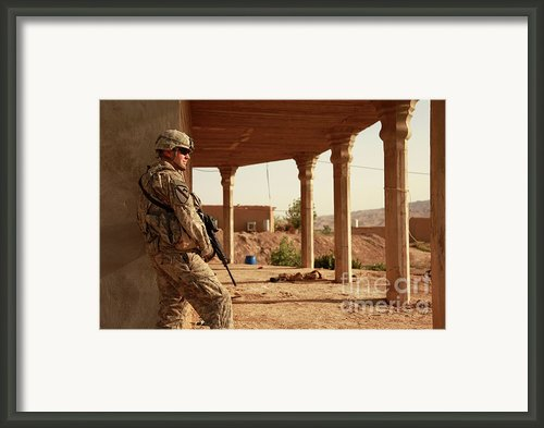 U.s. Army Soldier Pulls Security Framed Print By Stocktrek Images