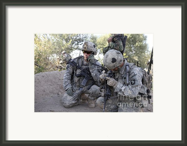 U.s. Army Soldier Radios In His Teams Framed Print By Stocktrek Images