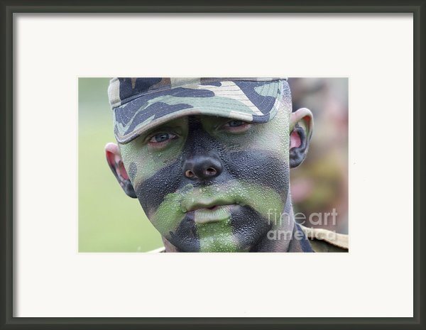 U.s. Army Soldier Wearing Camouflage Framed Print By Stocktrek Images