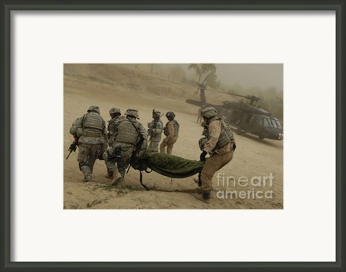 U.s. Army Soldiers Medically Evacuate Framed Print By Stocktrek Images