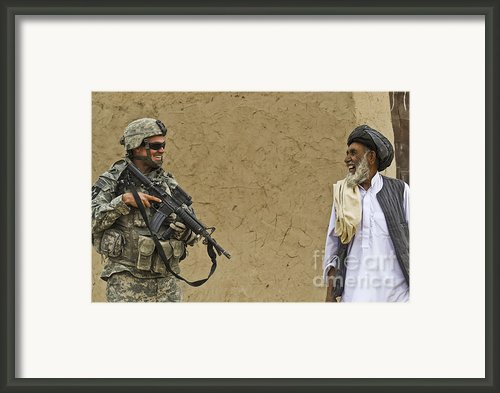 U.s. Army Specialist Talks To An Afghan Framed Print By Stocktrek Images