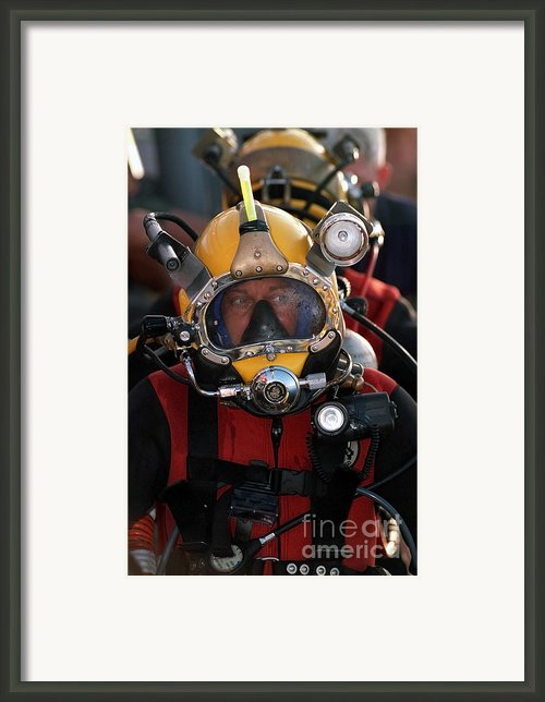 U.s. Navy Officer Wears The Mk-21 Mod Framed Print By Stocktrek Images