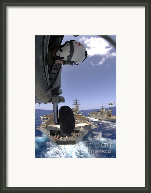 U.s. Navy Petty Officer Leans Framed Print By Stocktrek Images