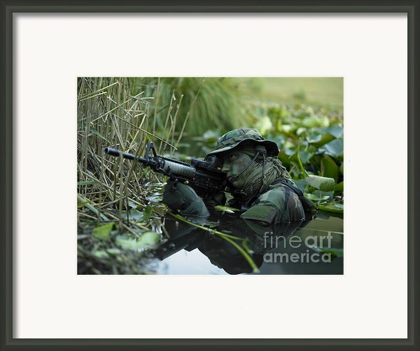 U.s. Navy Seal Crosses Through A Stream Framed Print By Tom Weber