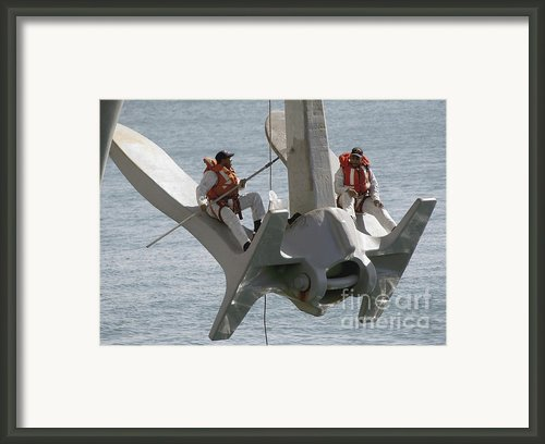 U.s. Navy Servicemen Apply A Coat Framed Print By Stocktrek Images