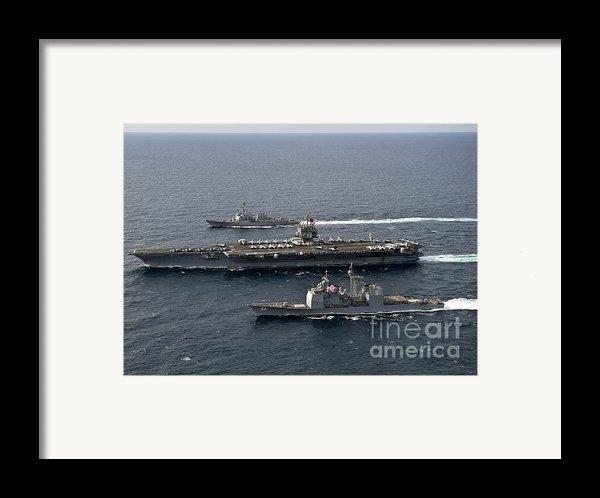 U.s. Navy Ships Transit The Atlantic Framed Print By Stocktrek Images