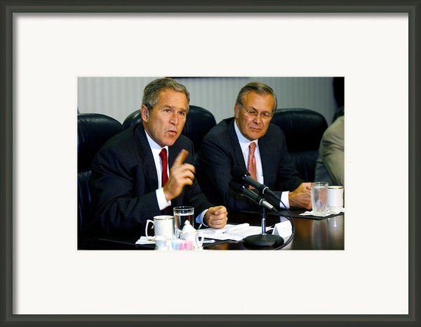 U.s. President George W. Bush Answers Framed Print By Everett