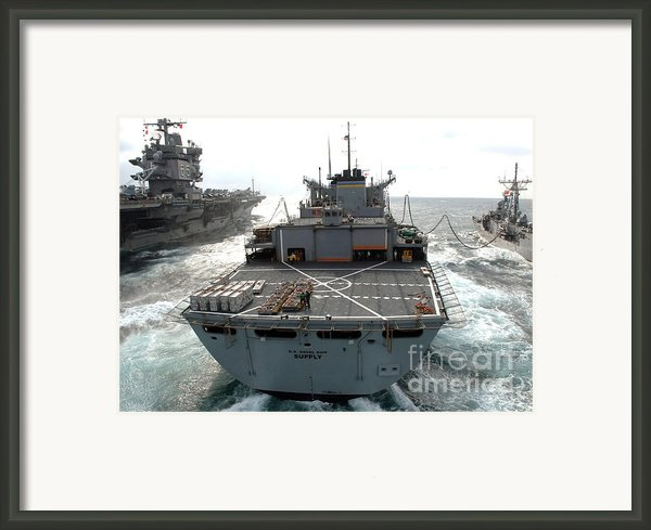 Usns Supply Conducts A Replenishment Framed Print By Stocktrek Images