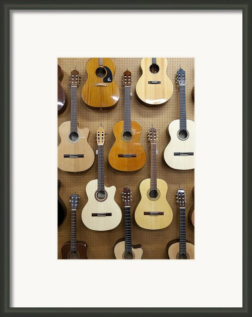 Various Guitars Hanging From Wall Framed Print By Lisa Romerein