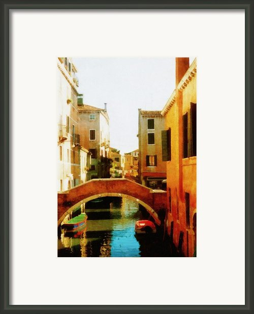Venice Italy Canal With Boats And Laundry Framed Print By Michelle Calkins