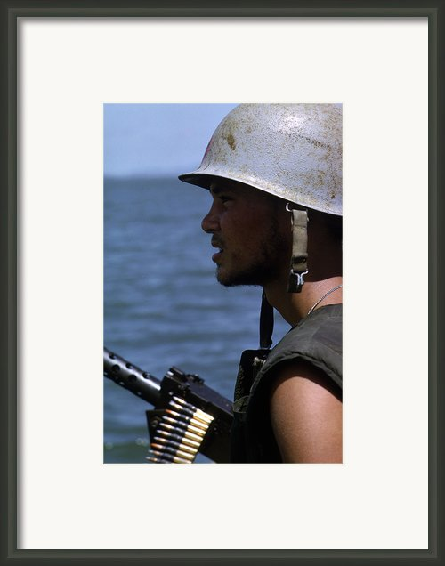 Vietnam War, A Navy Gunner Mans His 50 Framed Print By Everett