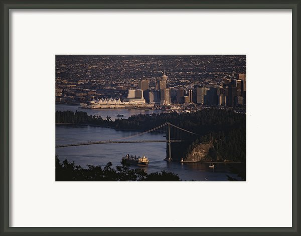 View Of Vancouver, British Columbia Framed Print By Annie Griffiths