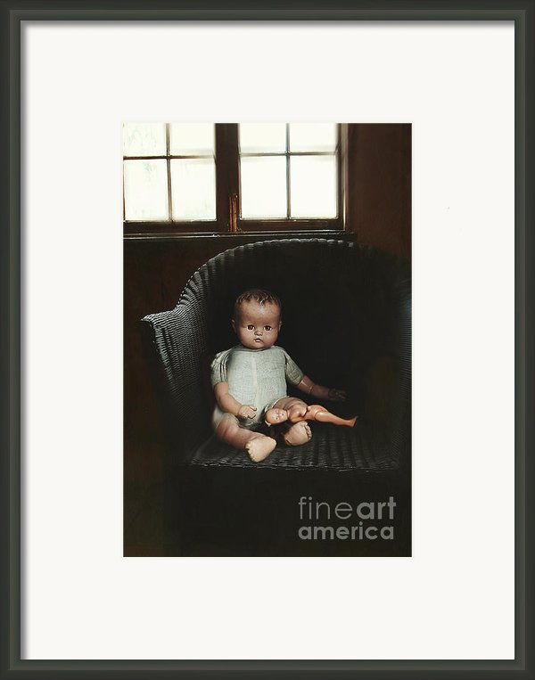 Vintage Dolls On Chair In Dark Room Framed Print By Sandra Cunningham