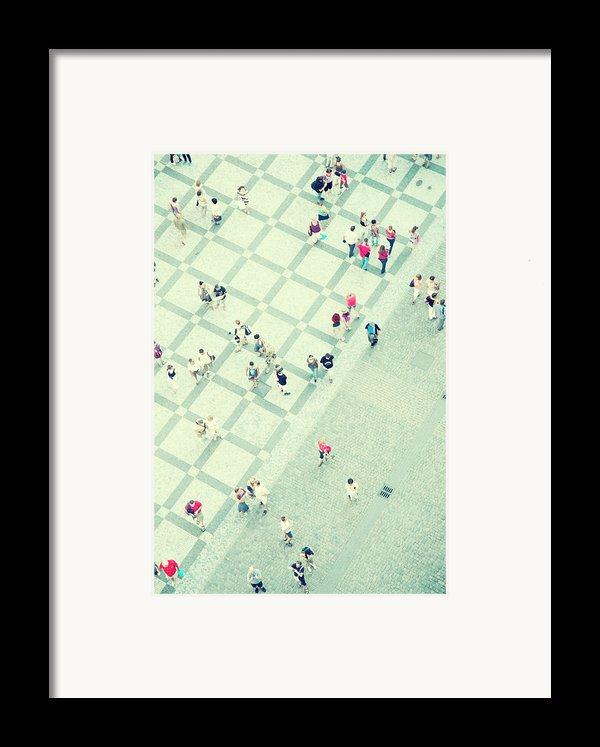 Walking People Framed Print By Carlo A