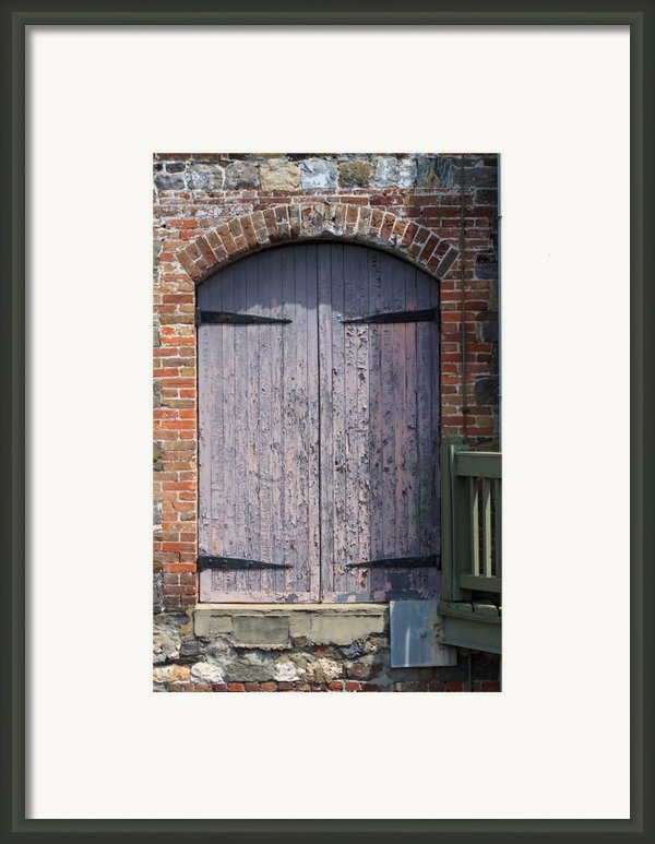 Warehouse Wooden Door Framed Print By Thomas Marchessault