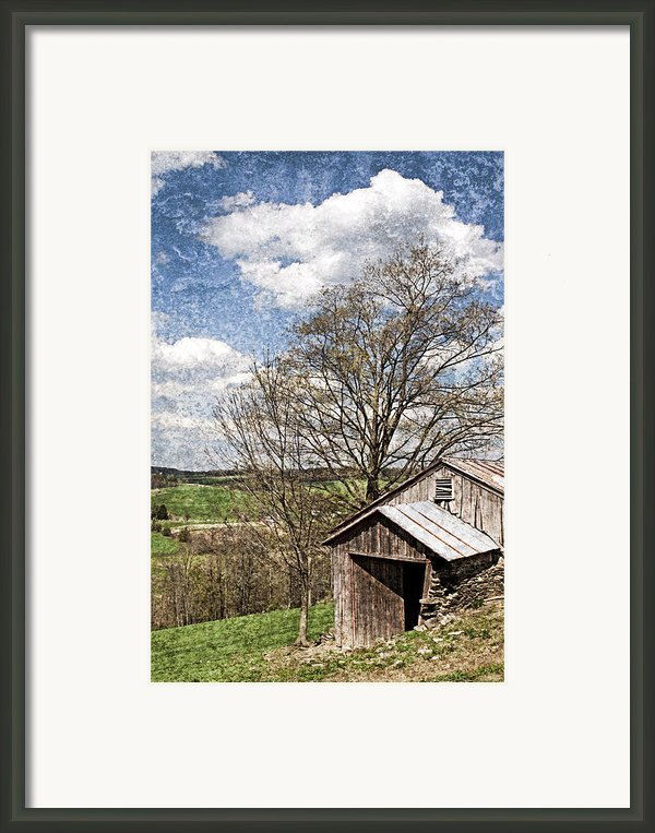 Weathered Hillside Barn Spring Framed Print By John Stephens