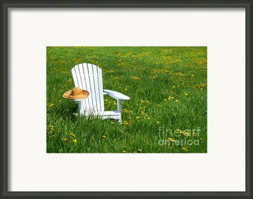 White Chair With Straw Hat Framed Print By Sandra Cunningham