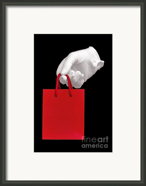 White Glove Holding A Red Gift Bag Framed Print By Richard Thomas