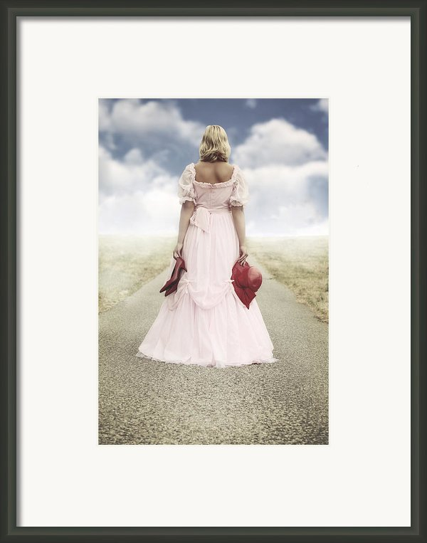 Woman On A Street Framed Print By Joana Kruse