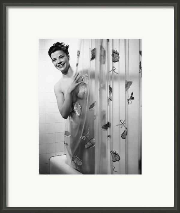 Woman Peering Through Shower Curtain, (b&w), Portrait Framed Print By George Marks