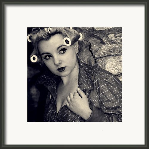 Woman Wearing Curlers And A Raincoat Framed Print By Joana Kruse