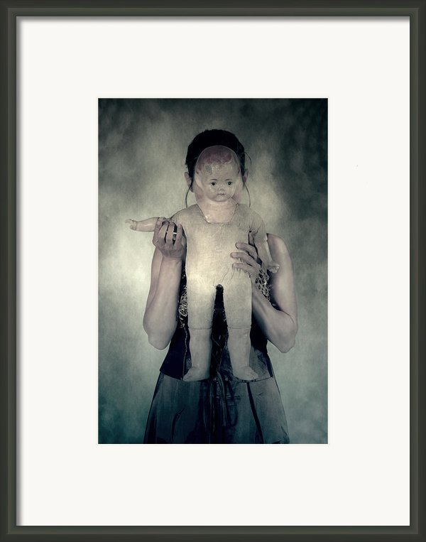 Woman With Doll Framed Print By Joana Kruse
