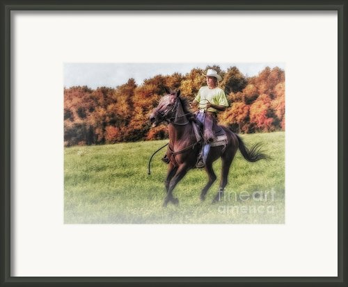 Wrangler And Horse Framed Print By Susan Candelario