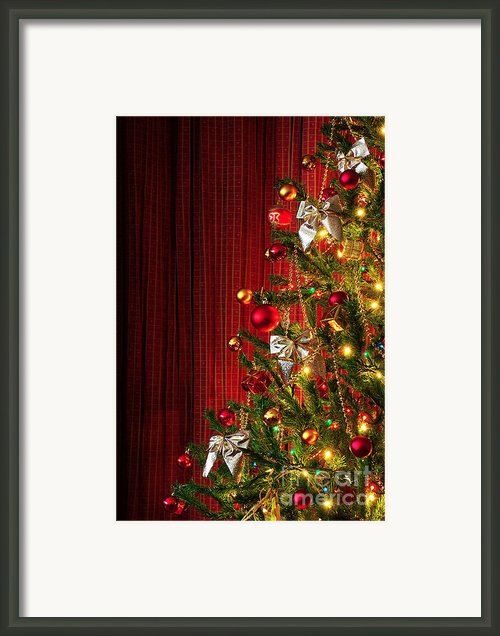 Xmas Tree On Red Framed Print By Carlos Caetano