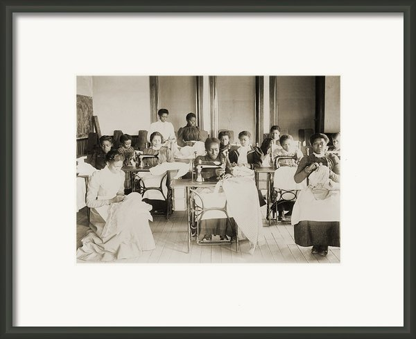 Young African American Women Sewing Framed Print By Everett