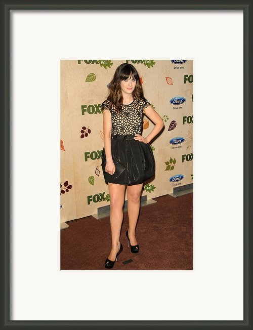 Zooey Deschanel Wearing A Collette Framed Print By Everett