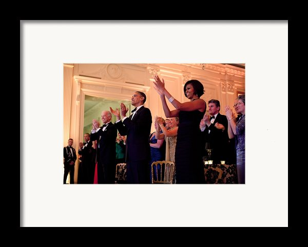 President And Michelle Obama Applaud Framed Print By Everett