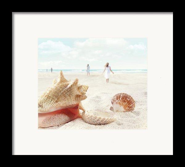 Beach Scene With People Walking And Seashells Framed Print By Sandra Cunningham
