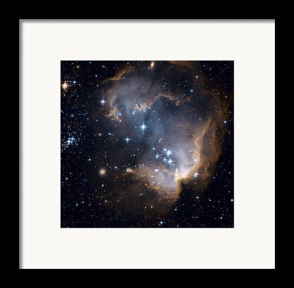 Bright Blue Newborn Stars Blast A Hole Framed Print By Esa And Nasa