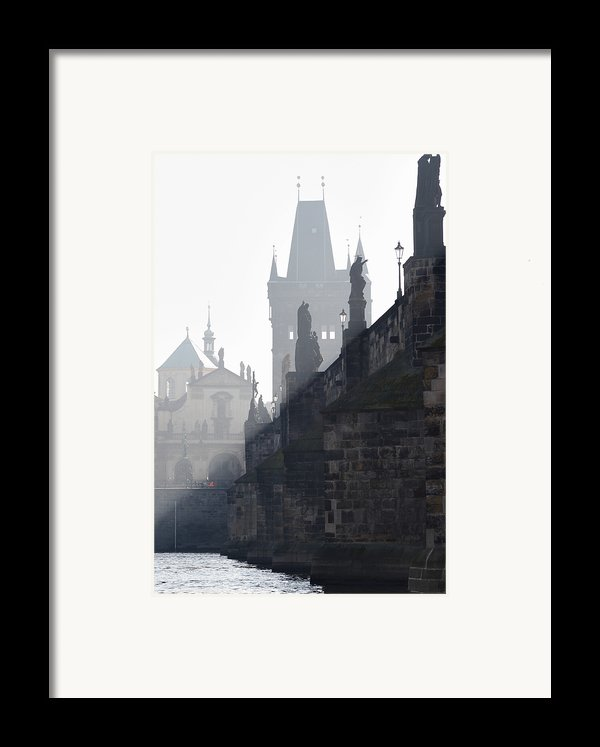 Charles Bridge In The Early Morning Fog Framed Print By Michal Boubin