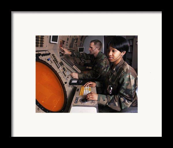 Control Technicians Use Radarscopes Framed Print By Stocktrek Images