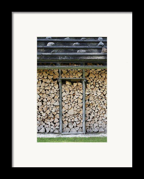 Firewood Stack Framed Print By Frank Tschakert