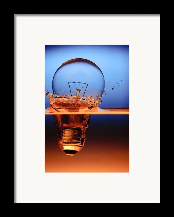 Light Bulb And Splash Water Framed Print By Setsiri Silapasuwanchai