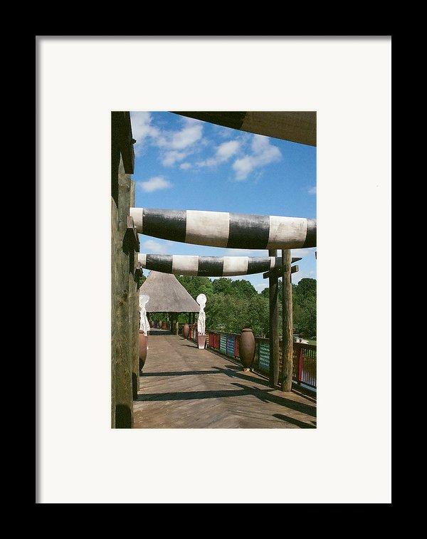 Lone Walk Framed Print By Julian Bralley
