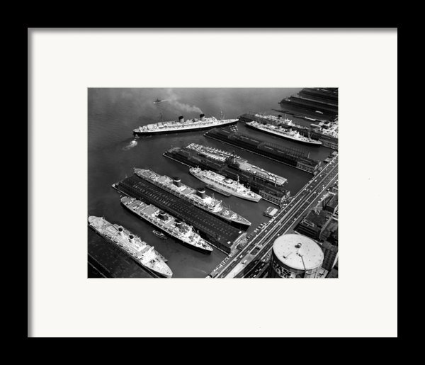 Luxury Liners Flanking An Aircraft Framed Print By Everett
