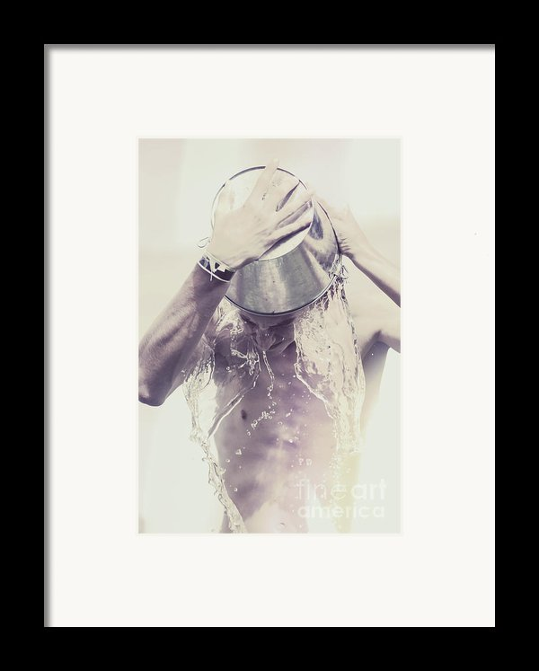 Man Pouring Cold Water From Wine Cooler Over Body Framed Print By Ryan Jorgensen