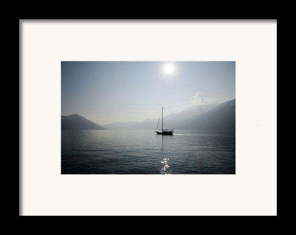 Sailing Boat In Alpine Lake Framed Print By Mats Silvan